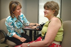 """CDC's Robyn Morgan (left), of the National Center for Chronic Disease Prevention and Health Promotion, is shown here taking the blood pressure of Rosamond R. Dewart, of the National Center for Infectious Diseases.  High blood pressure, also known as hypertension, is known as a """"silent killer"""" because people who have it often do not experience symptoms. Hypertension increases risk for heart disease and stroke, which are leading causes of death in women and men.   Date:2005 Content credits:/ CDC Connects Photo credit:James Gathany Image storage:xxxxxxxxxxxxx Support File:CD_120_DH/ 012  URL: http://www.cdc.gov/nccdphp/overview.htm URL Title: CDC – National Center for Chronic Disease Prevention and Health"""