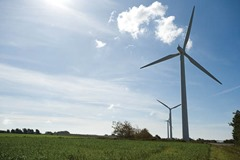 In 1997, Samsoe won a government competition to become a model renewable energy community. At the time Samsoe was entirely dependent on oil and coal, both of which it imported from the mainland. An offshore wind farm comprising 10 turbines (making a total of 21 altogether including landbased windmills), was completed, funded by the islanders. The people of Samsoe heat their homes with straw burned in a central heating system and they power some vehicles on biofuel which they also grow. Now 100% of its electricity comes from wind power and 75% of its heat comes from solar power and biomass energy. An Energy Academy has opened in Ballen, with a visitor education center.